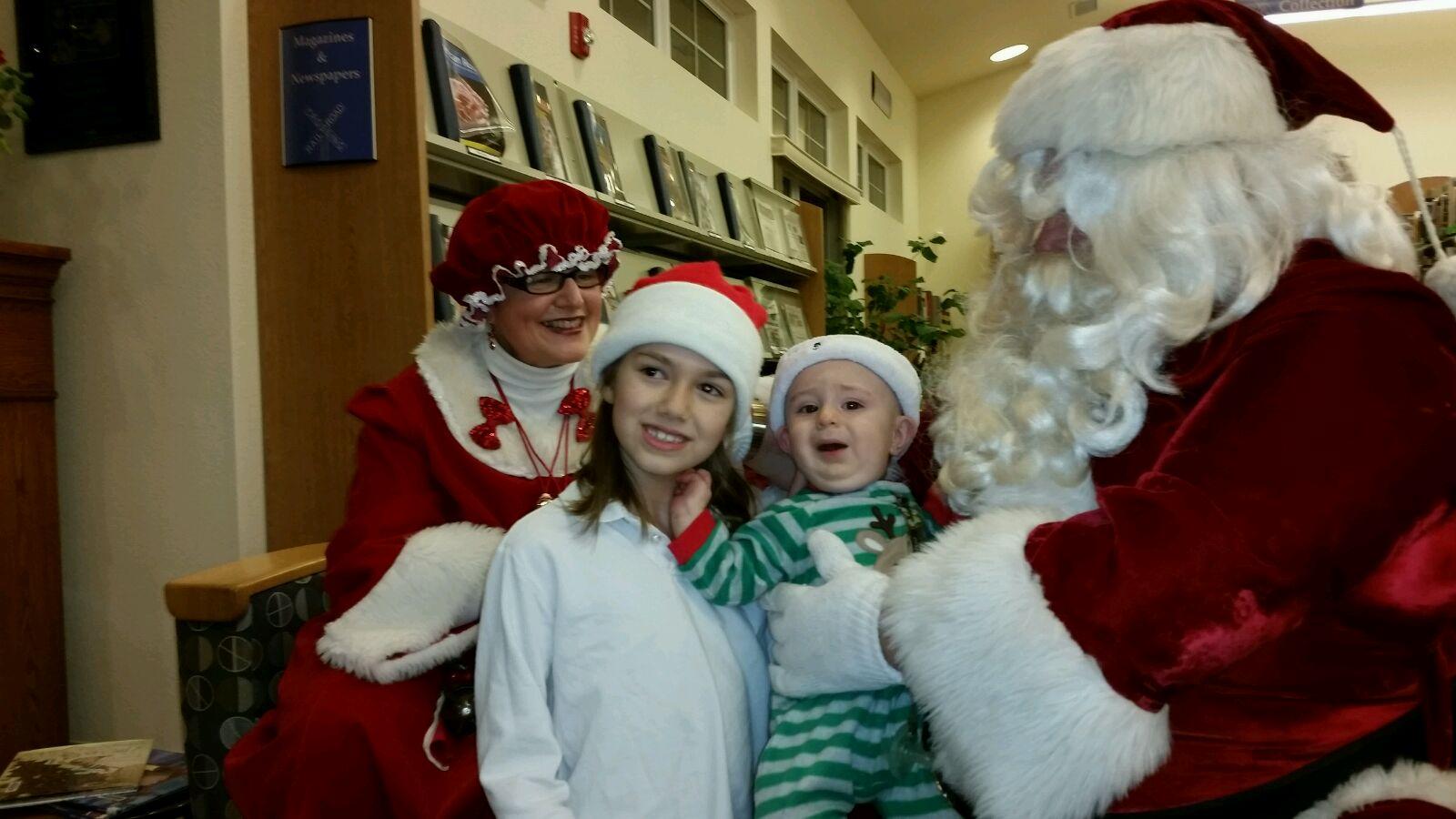 Mr. & Mrs. Santa visit the library
