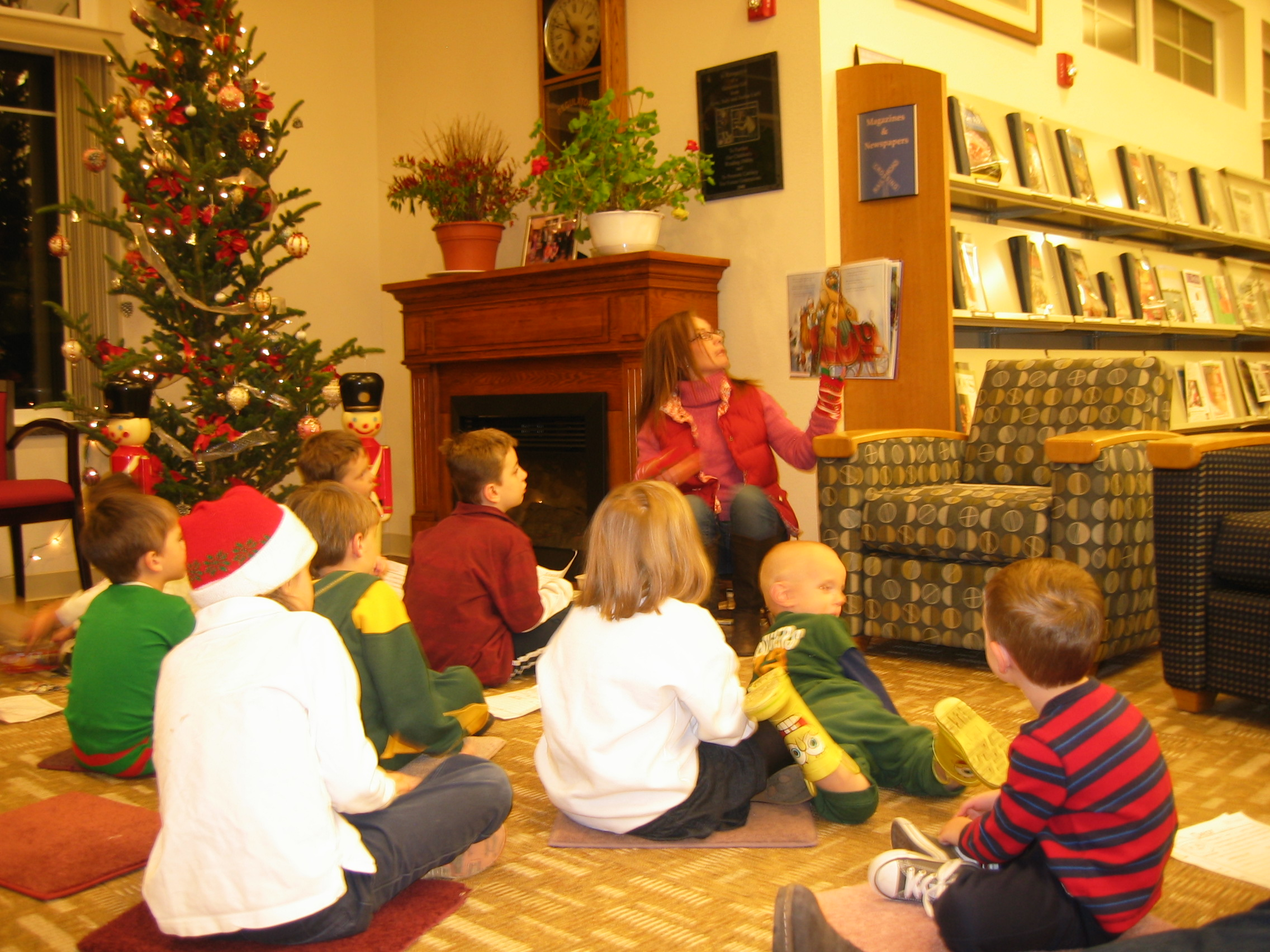 Miss Lisa is reading to the children before Santa arrives!
